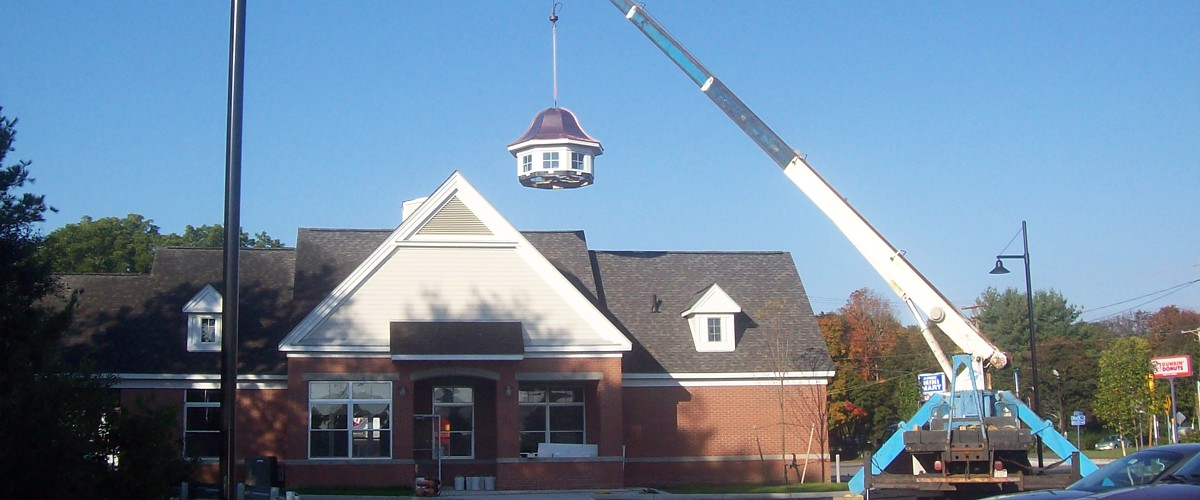 Custom cupola being placed by crane